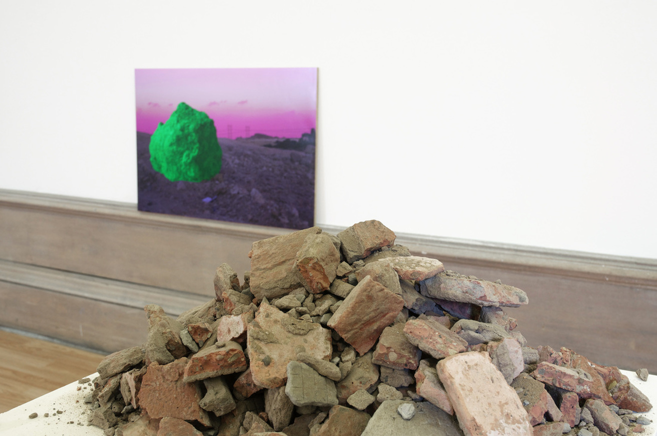 Experiments in Diasporic Space II,Narratives of Conflict and Longing (Colourspace), digital print, building sand, plywood, rubble, plinth, 2014 @Sulaiman Majali (A collaboration with  Sharif Elsabagh )