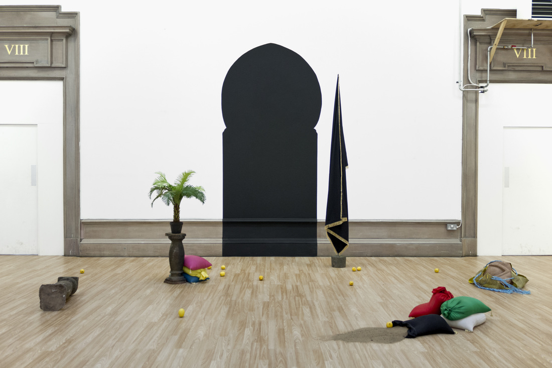 The power and the glory and other things that have nothing to do with war,  silk sand-bags, sand stone, black flag, black paint, concrete, artificial palm, building sand, lemons, 2015 @Sulaiman Majali