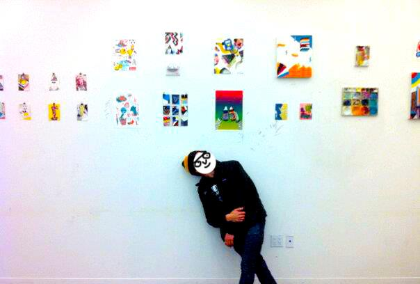 Brandon Elijah Johnson with his paintings/drawings. 2015