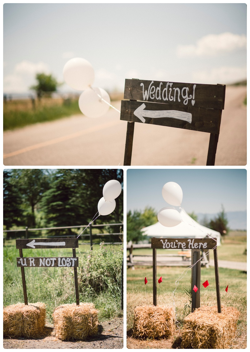 The handmade wooden wedding signs leading the way to the wedding location just outside of Bozeman, Montana.