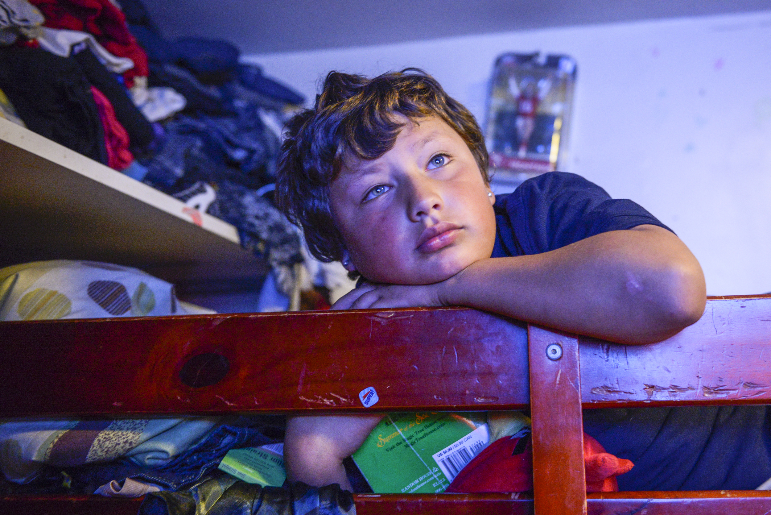 Christopher, 8, watches TV. He has been diagnosed with ADHD.