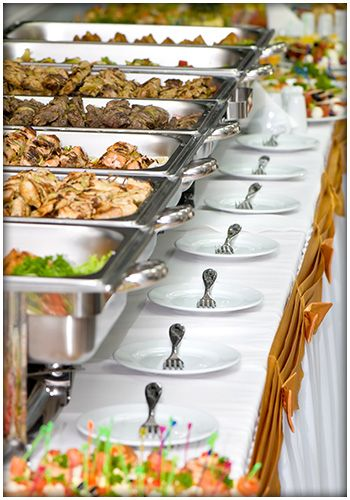 Wedding catering table featuring a variety of meats.