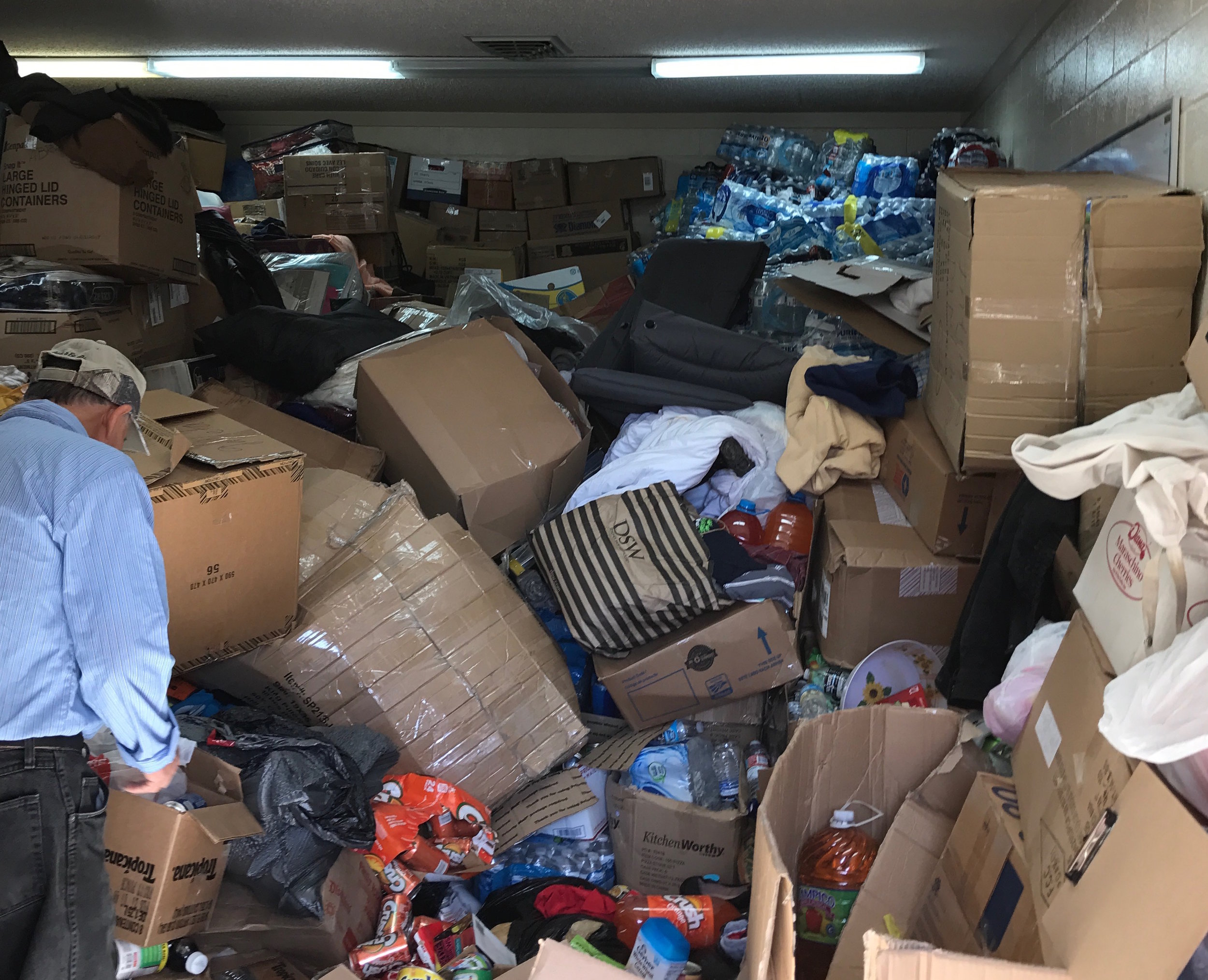 Donated clothing, food, water, and supplies to be sorted and organized for daily trips across to Nuevo Laredo to support the Cuban migrant community in limbo. The Holding Institute serves as the Laredo staging site for this ministry of hospitality and presence work.
