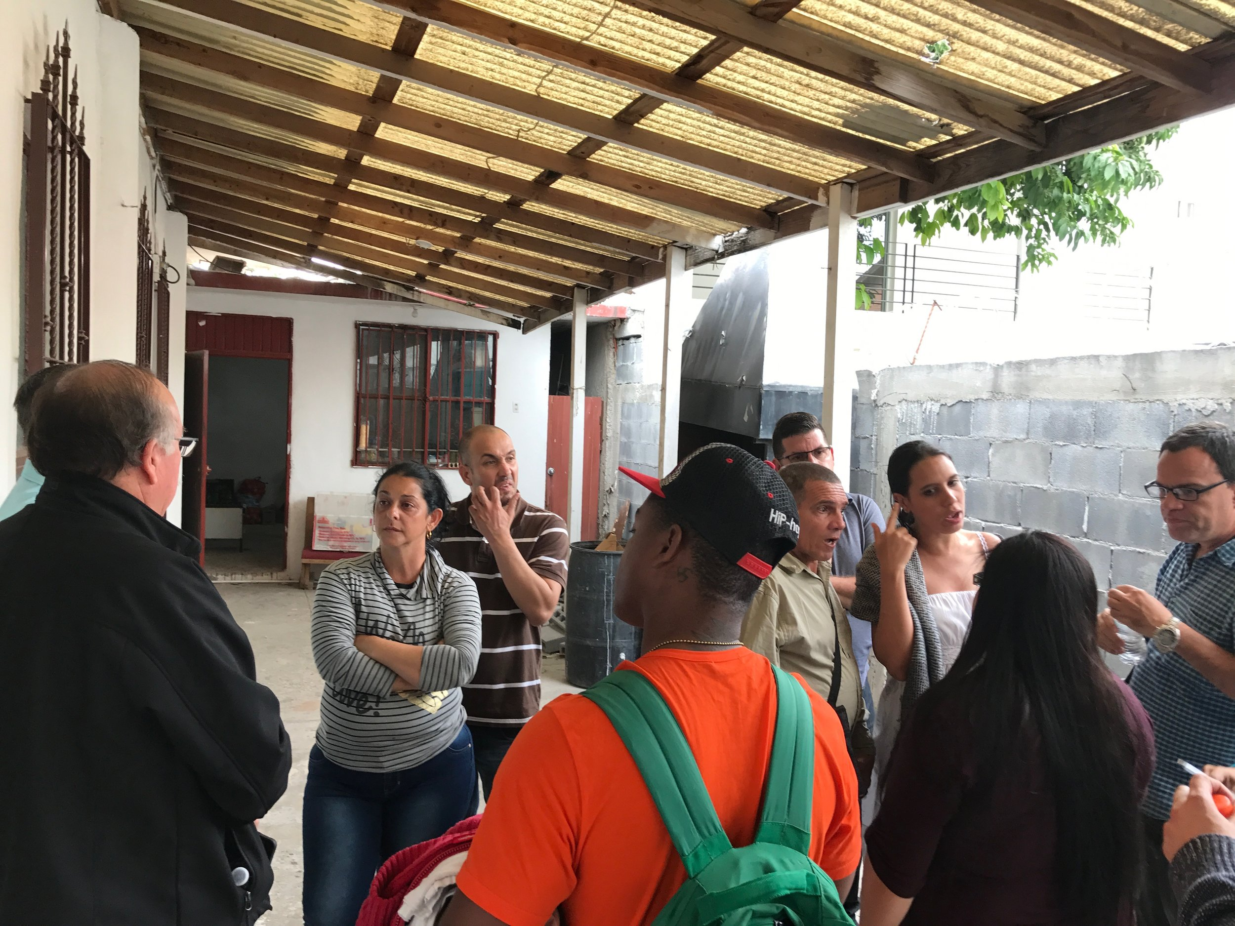 After unloading supplies at the church, the Cuban migrant community and Methodist and Baptists discuss the day's activities. After this activity, some of the group went to visit with the local immigration and refugee services office to gain insight on their situation from the Mexican government's standpoint.