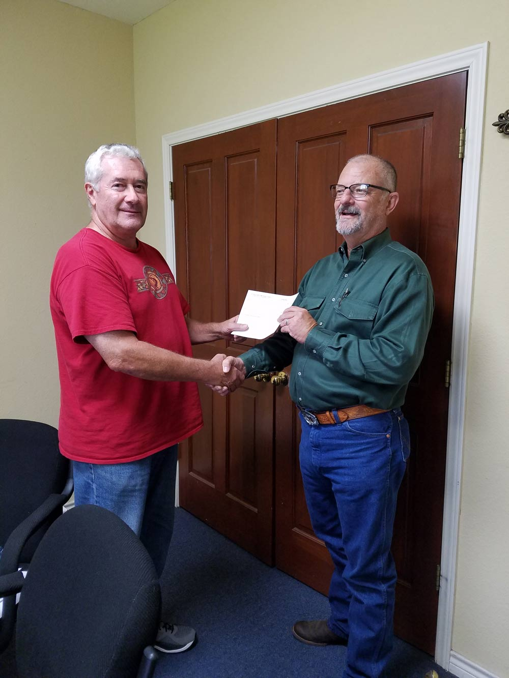 Pictured is Brian Mitchell, Finance Chairperson, handing Pastor Randall Hilburn a check for immediate transmission to the conference treasurer.