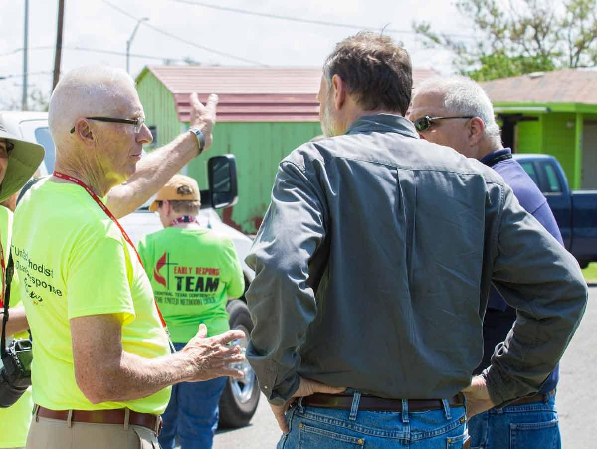 Disaster Response Coordinator Eugene Hileman briefs Robert Schnase on efforts on Gregory.