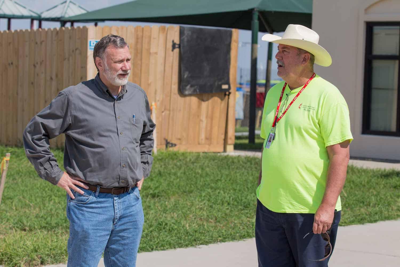 Bishop Schnase visits with Corpus Christi site coordinator Jim Callis at First UMC, PORTLAND