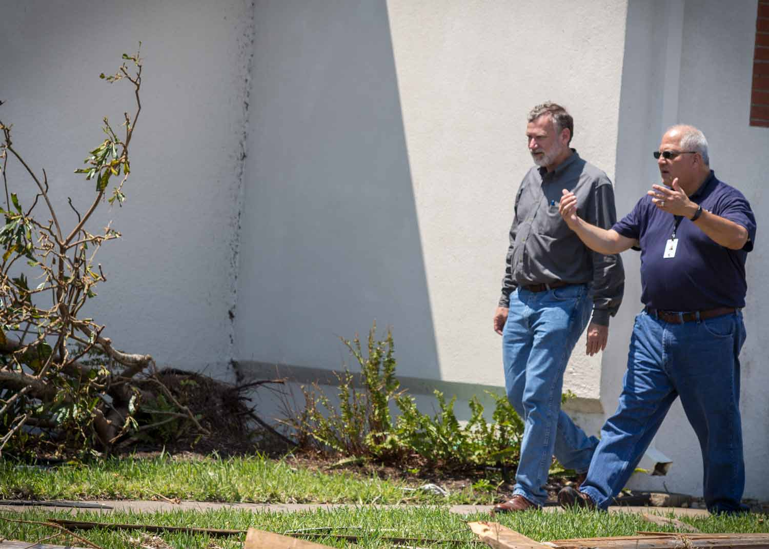 Robert Schnase, Bishop of the Rio Texas Annual Conference surveys damage at First UMC, Rockport, Texas with Director of Outreach Vitality, Abel Vega.