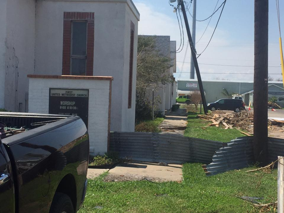 POWER LINES AND POLES ARE DOWN ALL OVER ROCKPORT INCLUDING AT FIRST UMC.
