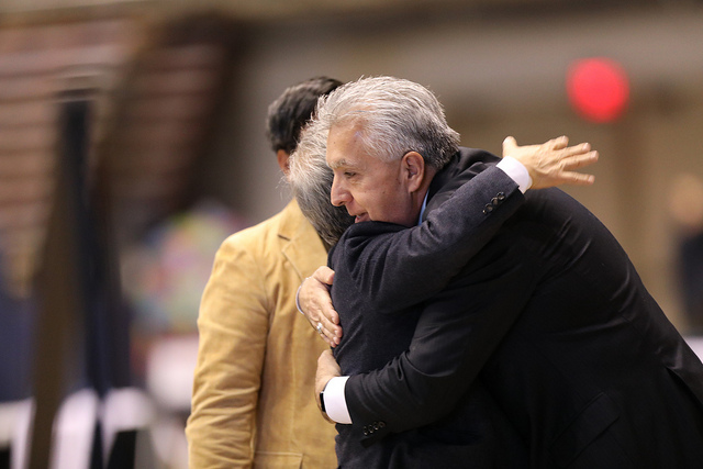 Bishop Robert Hoshibata embraces  Bishop Ruben Saenz during the prayer time before Communion.  Photo by Kathleen  Barry, UMNS.Mawla Zothan
