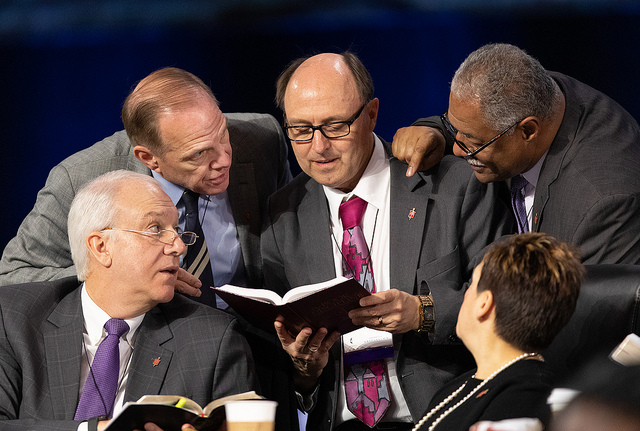 Bishops confer over the issue of  whether the legislative committee can refer items to the denomination's  Judicial Council for review during the 2019 United Methodist General  Conference. Clockwise from lower left are: Thomas  Bickerton, John Shcol, David Bard, Julius Trimble and Cynthia Harvey.  Photo by Mike DuBose, UMNS.