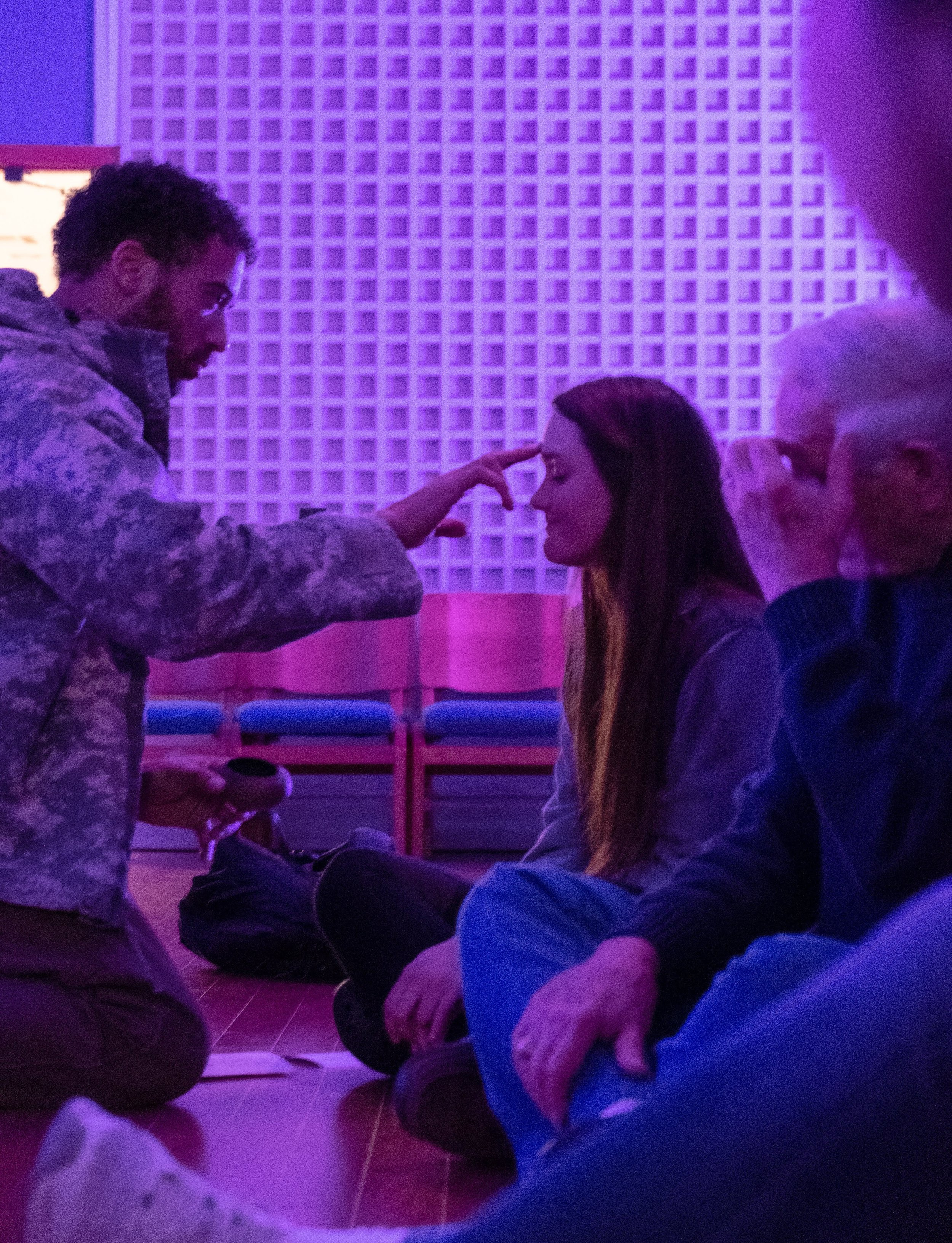 Texas State students receive and share ashes during Ash Wednesday worship at the United Campus Ministry. Photo credit: Tania Zapien