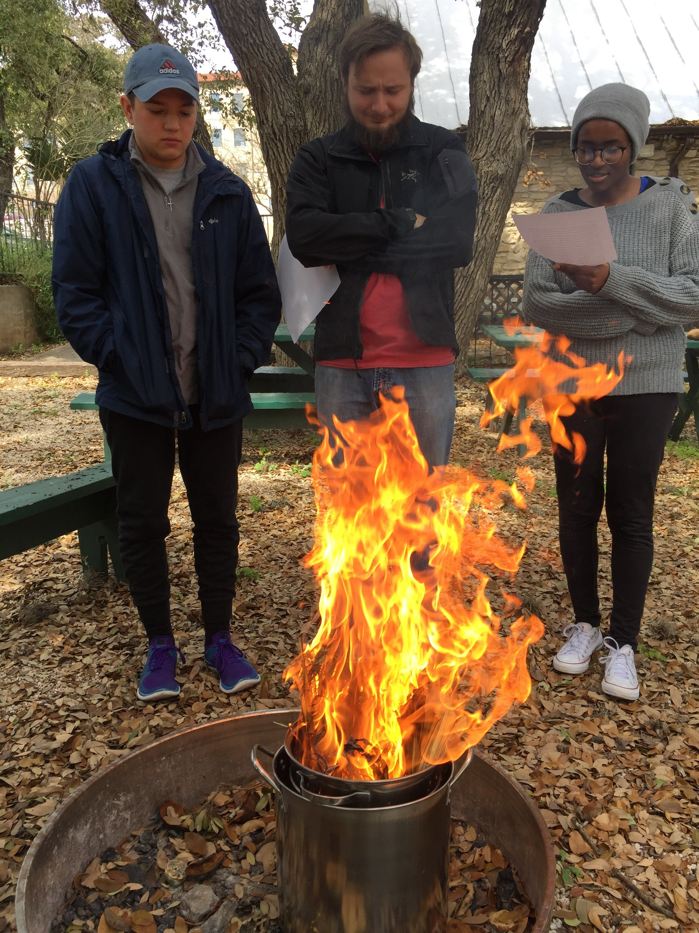 Texas State UCM students Evan Perez, Walker Metyko, and Consolatrice Nzoya prepare ashes from last year's palms.