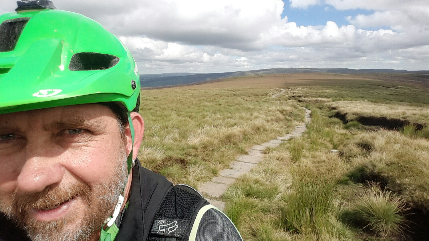 This is the Pennine way. It runs across the top of England from one side to the other.  There are 1000s of meters of these hand laid stone slabs that run across the tops.