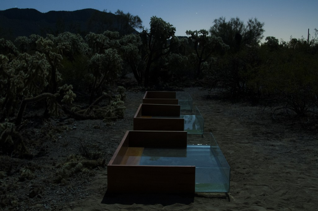 Installed   Pray for Rain   in the beautiful Sonoran desert, you must walk there by foot. The mahogany and glass pools glow in the moonlight and the water blows in the wind. The opening ceremony and party  – equal parts drumming ceremony, reflective moon pools, clay sculpting, hand drilled torches and joyous celebration.