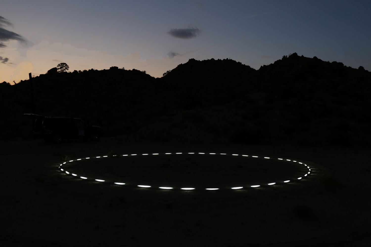 Lunar Ceremony  Flourescence 100' diameter   The fourth of my Installation series for the Mojave.   Always showing the same face, synchronous rotation, our only satellite, surrounded by a trace of infinite dust.  Waxing and Waning the formation of the most ancient calendars. Over the course of the Lunar cycle, from New Moon to New Moon - the course of 29.6 days, patterning the phases. Lighting up the the phases of the moon peacefully, from a hidden plateau in the Mojave desert. Ancient ritual, and symbolic parts of self, as rising and setting with the moon, however only revealed as the night falls to dusk. Circular in nature, but remaining parts, illuminated and drawn into Jungian shadow. Relevant and reflected into the sky.