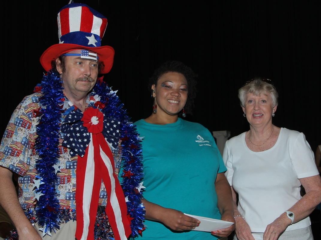 Left to right; 2014 Peachy Recipe Contest winners,Dwayne Shumpert, Wendy Blair, and Geraldine Knowles.