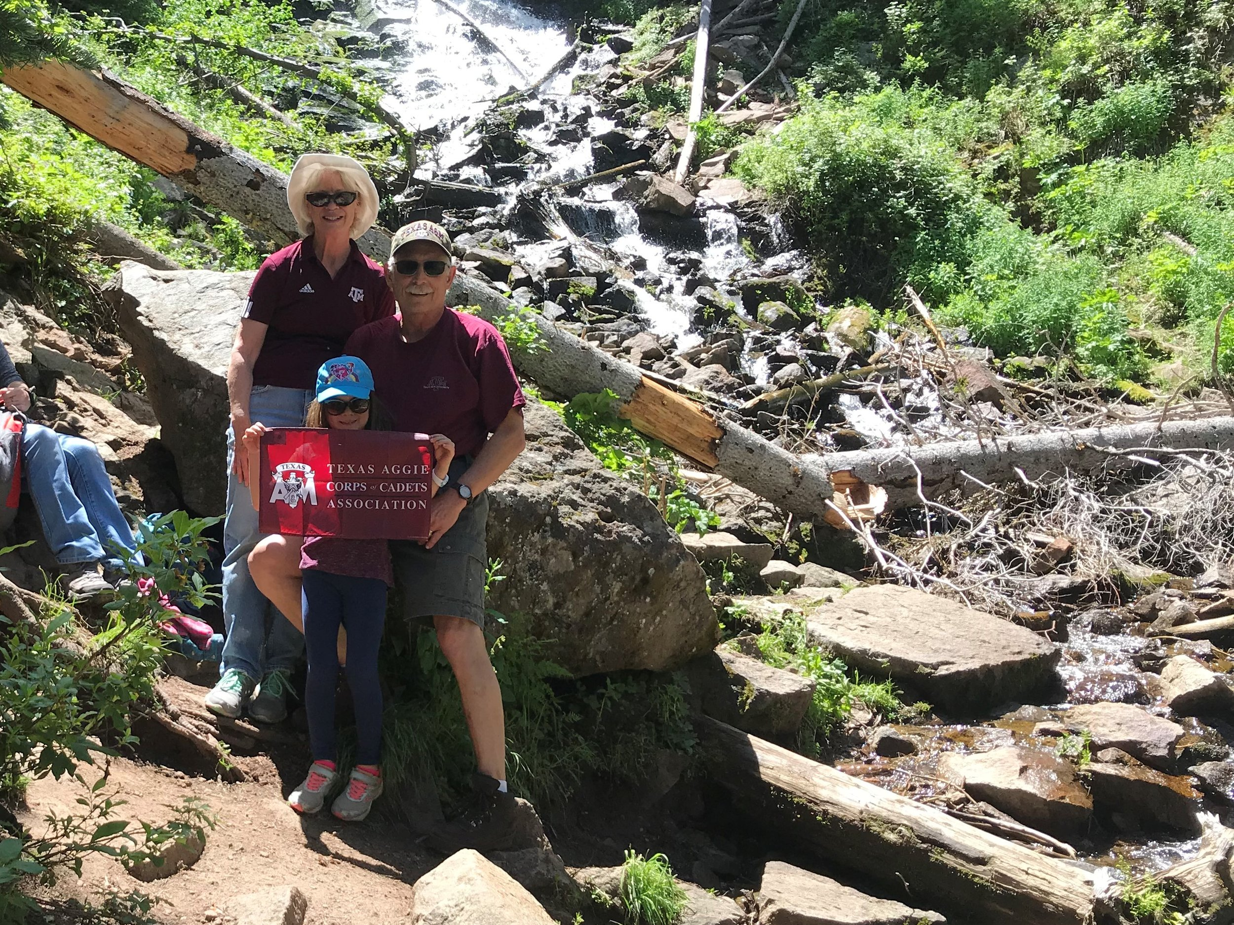 Jerry M. Easterly '73 with 'Nancy Easterly '74 and granddaughter Abigail Todd '35 at Cascade Falls above Big Meadow Reservoir near South Fork Colorado, July 2019.jpg