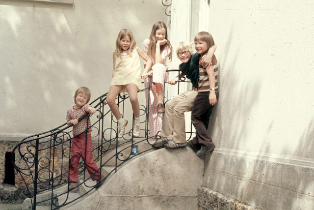 These kiddos were family friends who lived in  Paris . (I'm in the yellow-checked dress.)