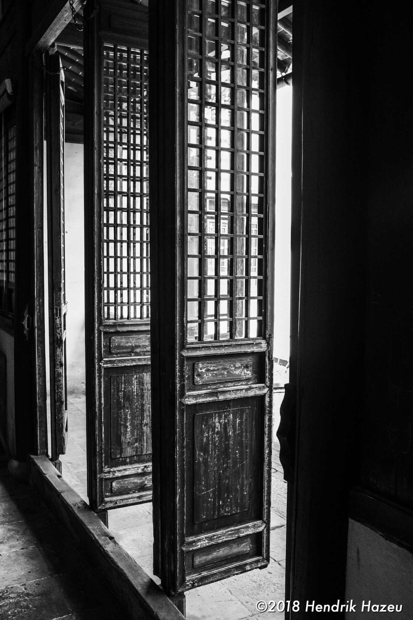 Courtyard doors, Fuji X100F, 23mm f/2 @f/5.6, 1/60sec ISO400 developed in LR CC mobile