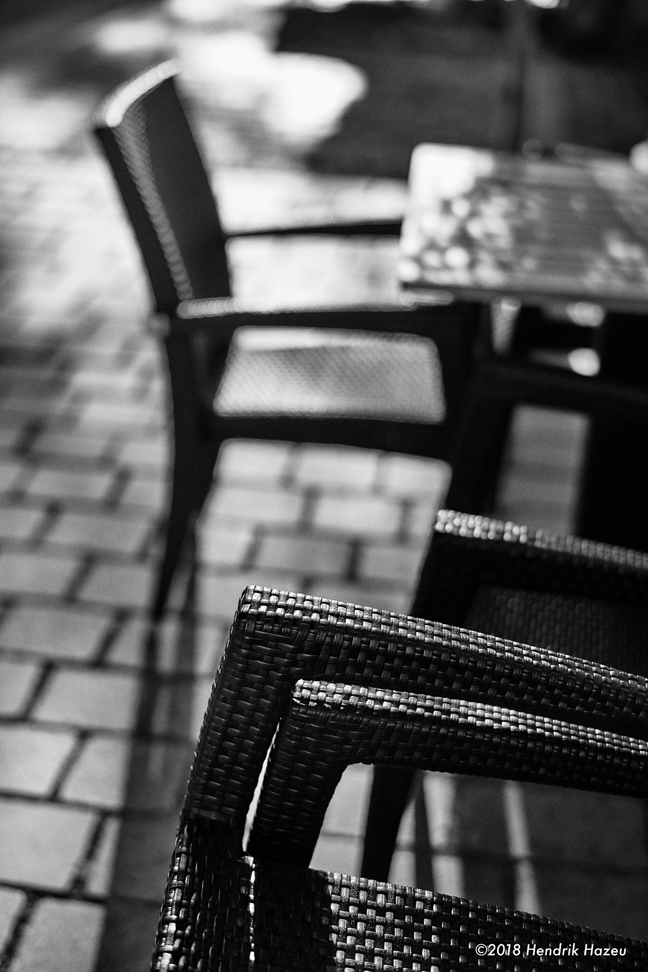 Shallow depth of field: Stacked chairs, Nikon 58mm f/1.4 on D850 @f/2, 1/8000 sec, ISO 450