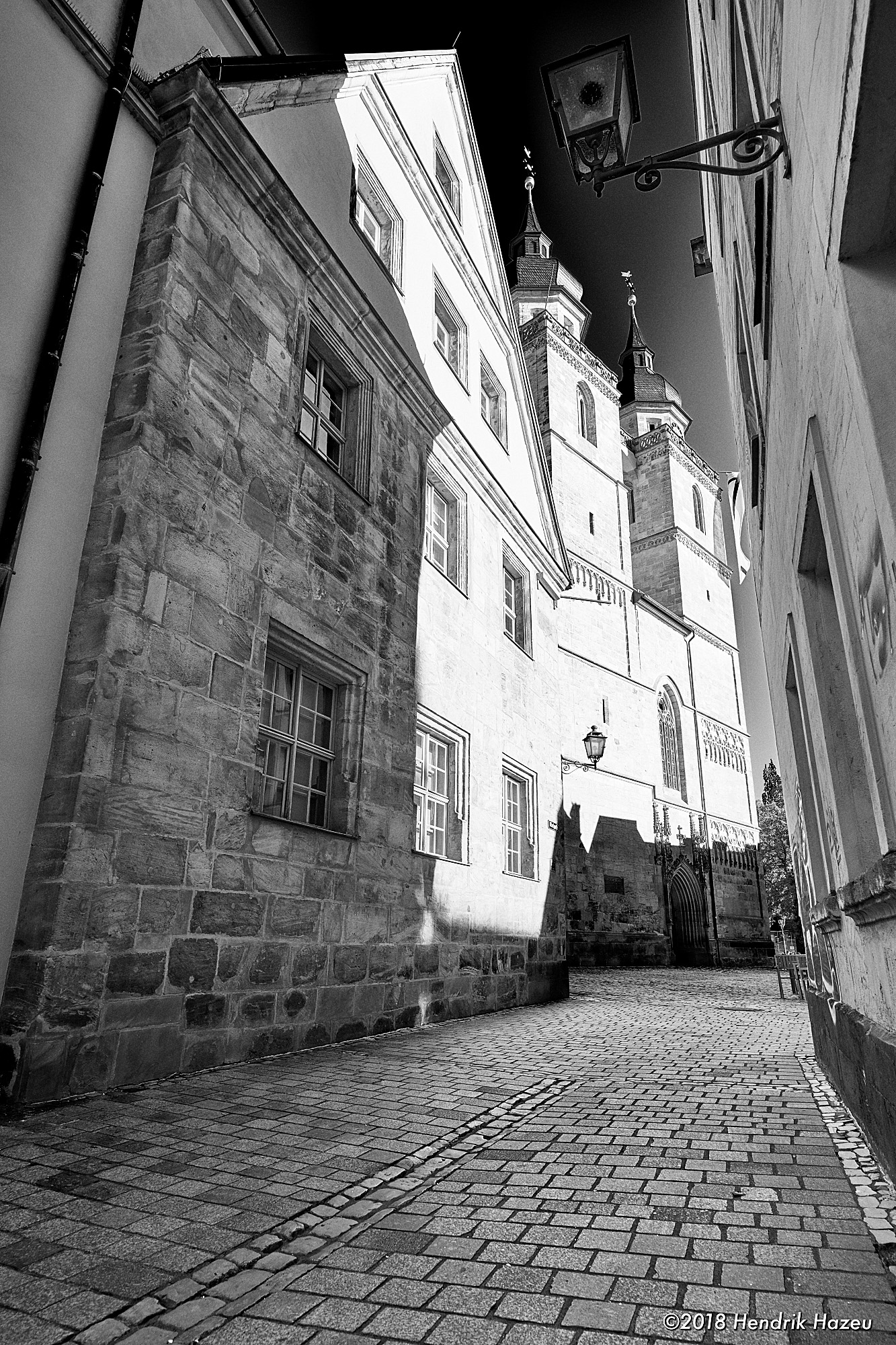 Alleyway with city church in Bayreuth, seen thru Nikkor AF-S 20mm f/1.8G @f/8, 1/40sec, ISO 80