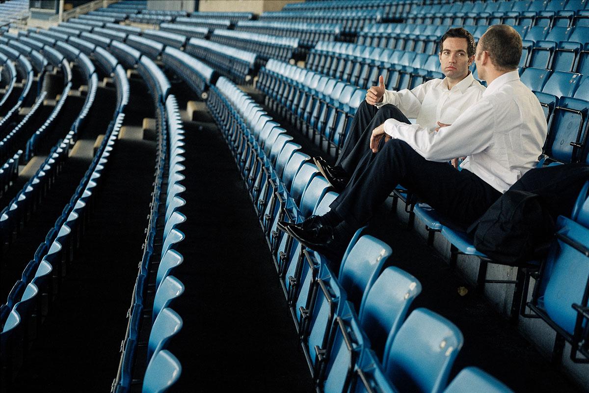 Businessmen at a stadium