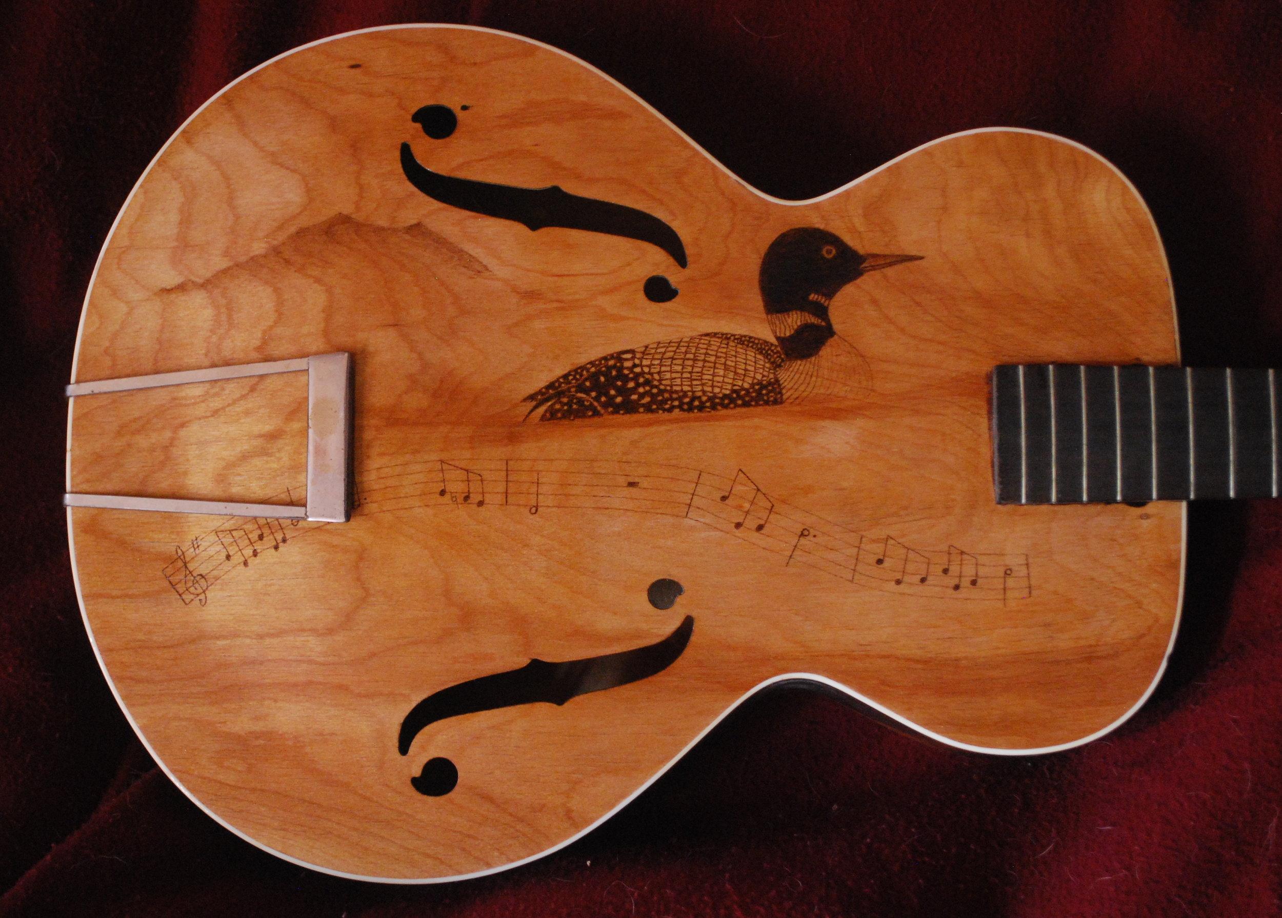 Original burn on a arch top K guitar..