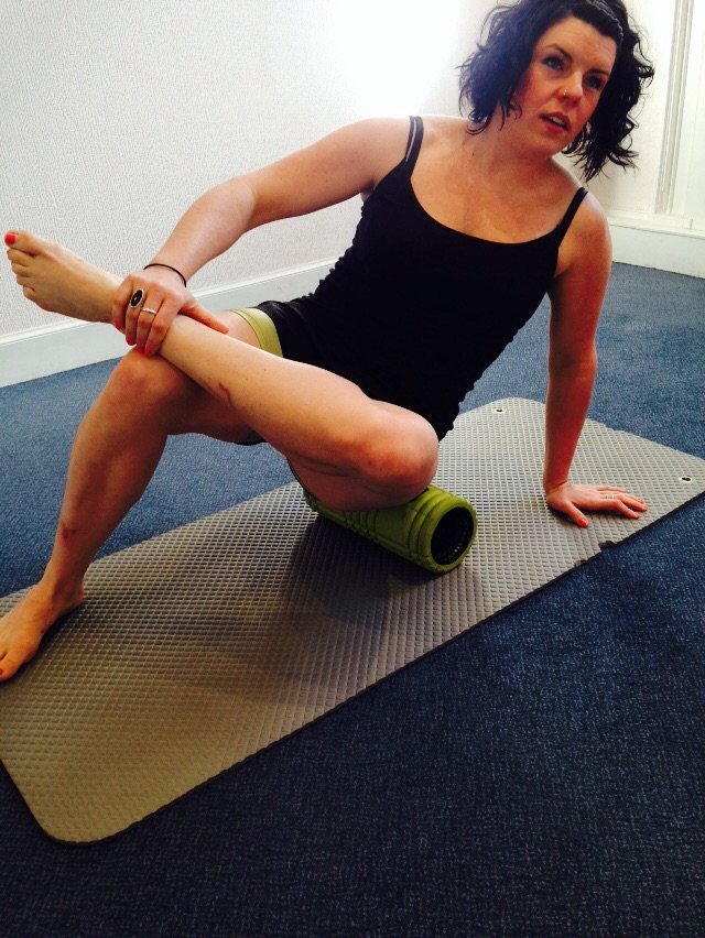 Foam roller on external rotators of the hip. Slightly stretching the hip adds a little extra to this.