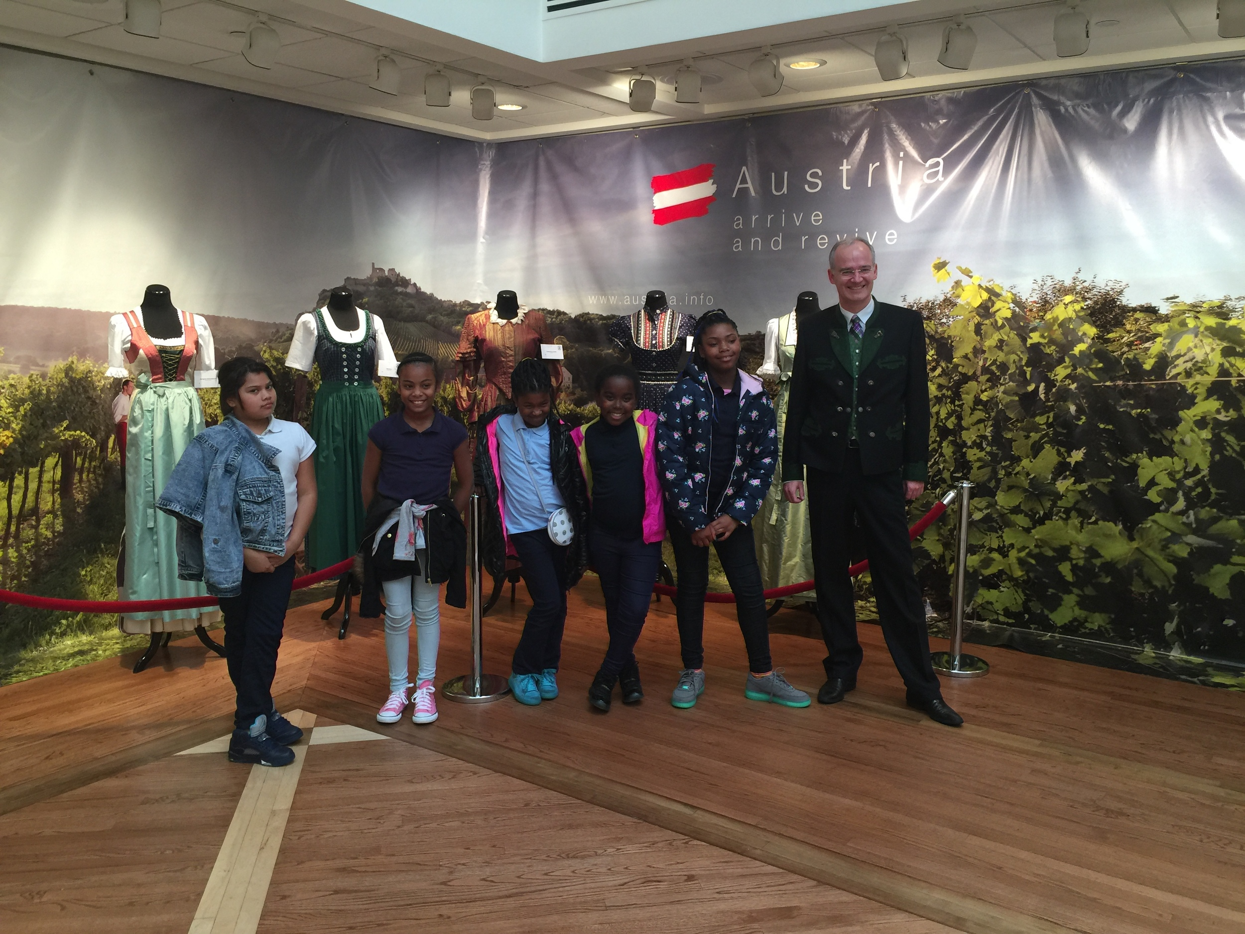 H.D. Cooke Elementary School 5th graders with Director of Press and Information Thorsten Eisingerich sporting his own traditional outfit on the occasion.