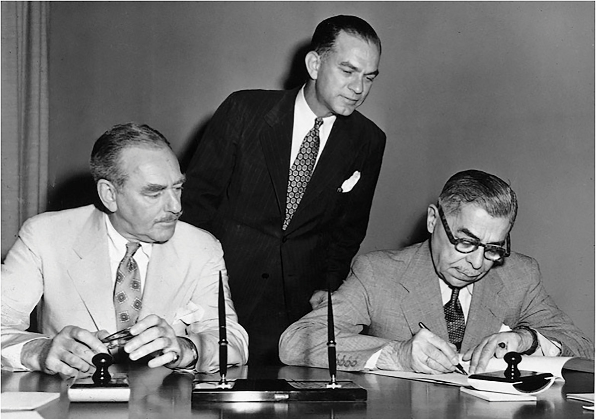 Signing of the inaugural Austrian-American Fulbright Agreement on June 6, 1952 in Washington, D.C. (Left to right) U.S. Secretary of State Dean Acheson, Senator Fulbright, Austrian Plenipotentiary Ludwig Kleinwaechter. (c) Fulbright Austria