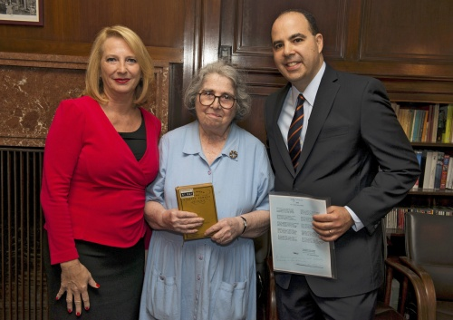 Speaker Bures restitutes a book to a descendant of a Holocaust survivor, July 5, 2017. Photo: David Plakke.
