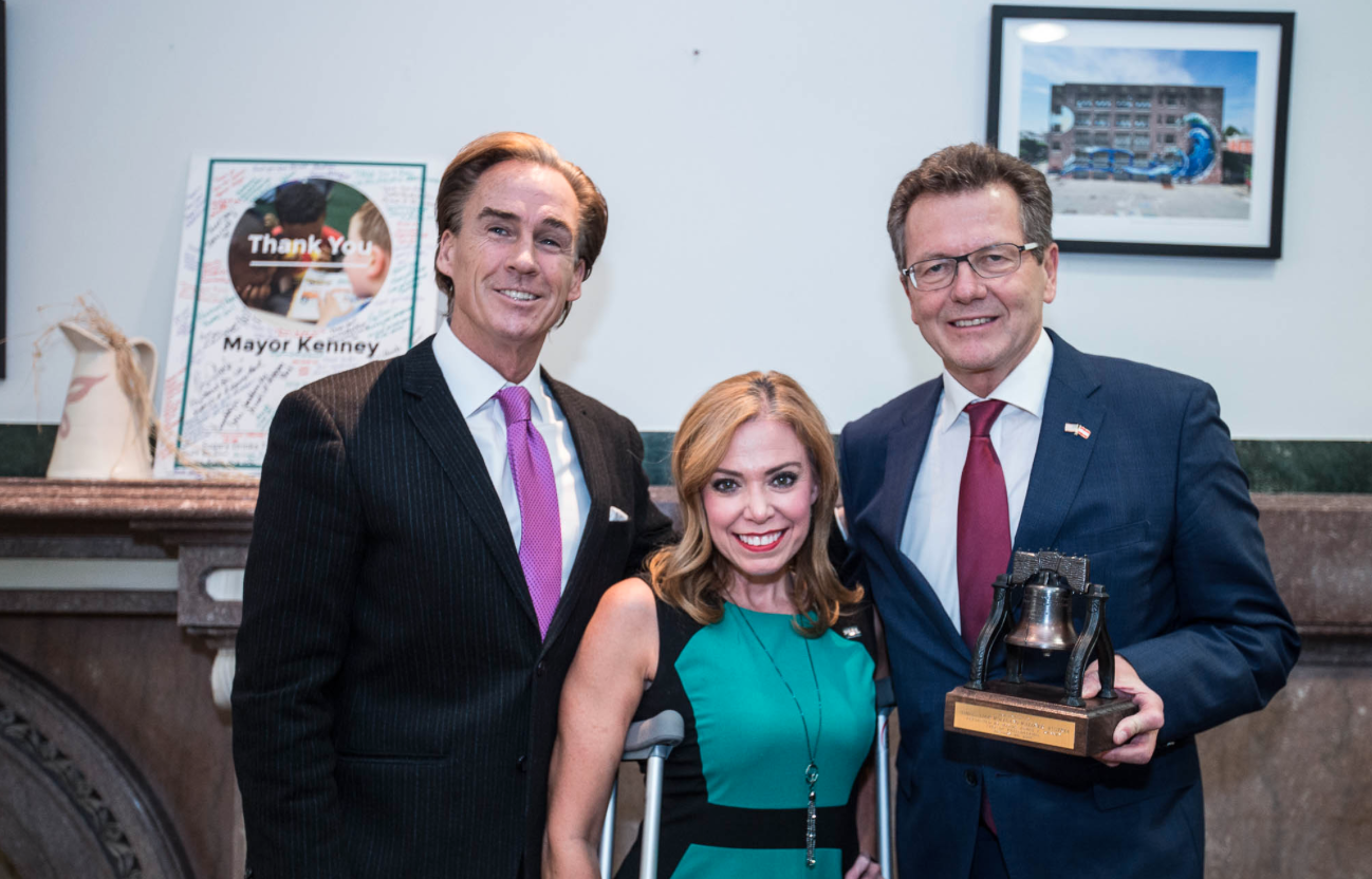 """Mike Stack, Lieutenant Governor of the Commonwealth of Pennsylvania, and City Representative Sheila Hess, welcomes Ambassador Waldner with a """"Liberty Bell"""""""
