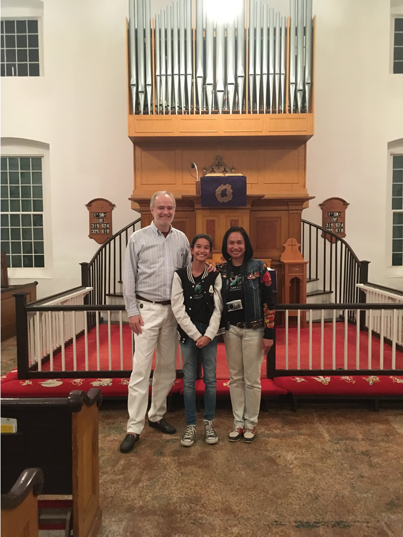 Thorsten Eisingerich with his daugher Thara and his wife Kulwadee at the Lutheran Church in New Ebenezer.