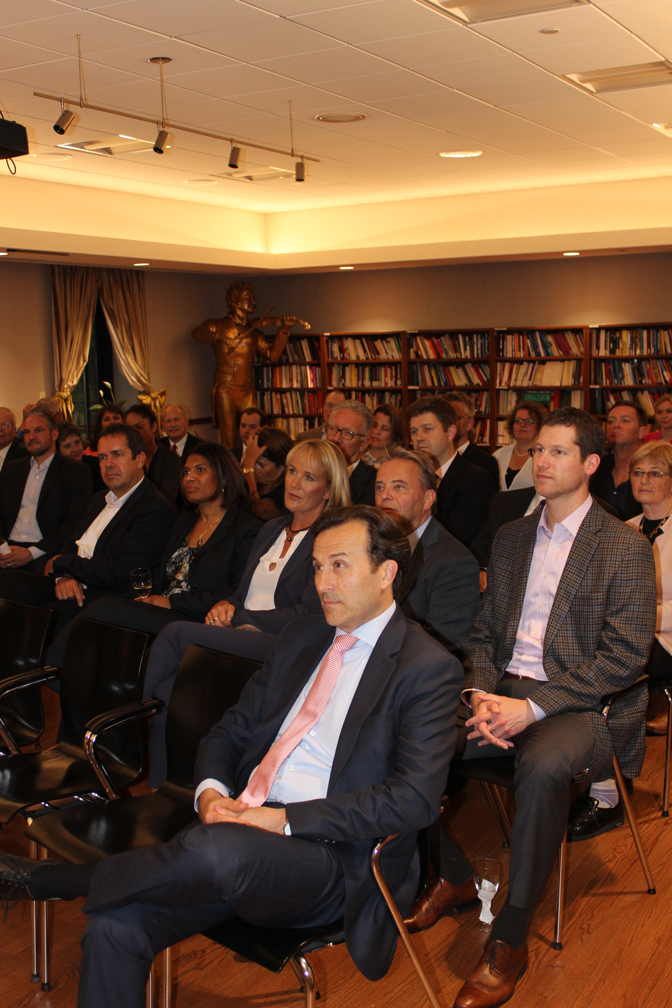 Economic Counselor Alexander Ehrlich-Adam (in front row) follows the presentation of the  GER Business Award 2018  winning team