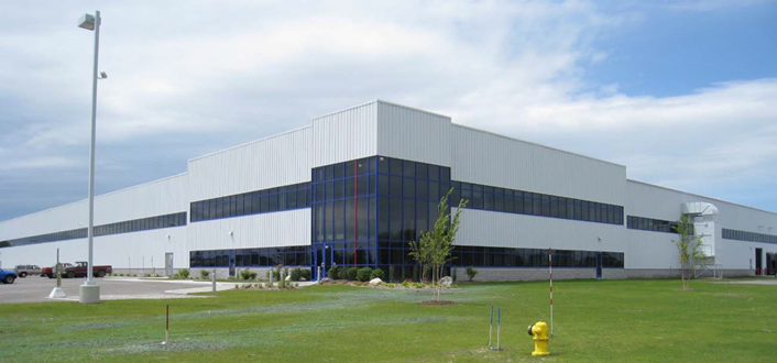 TGW Systems  will move its Norton Shores operations, currently on Grand Haven Road, to 1300 E. Mt. Garfield Road in Norton Shores. The 170,000-square-foot facility was occupied by Wacker Neuson. (c)  TGW Systems