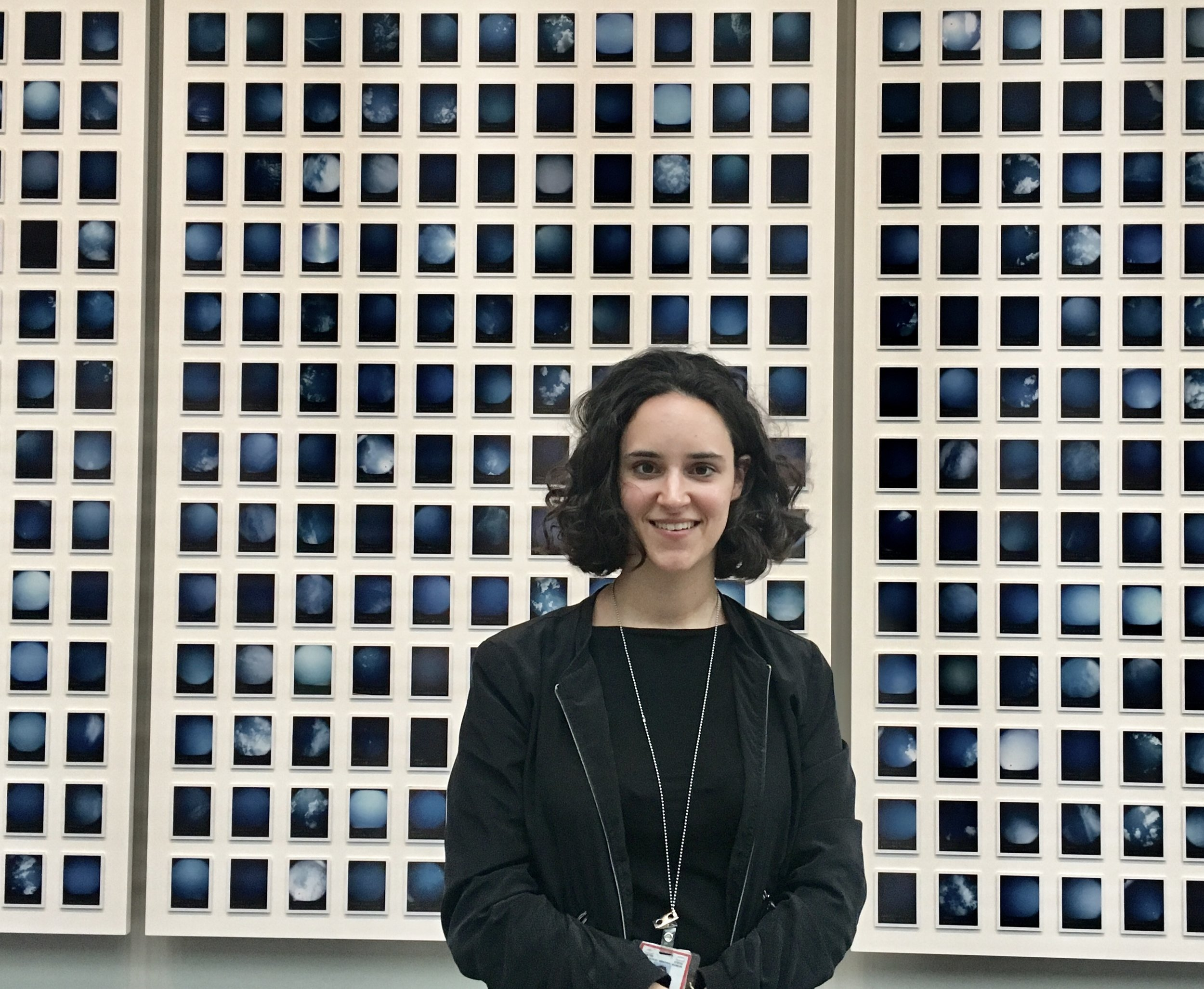 Caroline Schenk is pictured in front of a new installation in the museum titled   One Thousand and Seventy-Eight Blue Skies  . The artwork displays individual images of the sky photographed above every known Nazi concentration camp and killing center across Europe.
