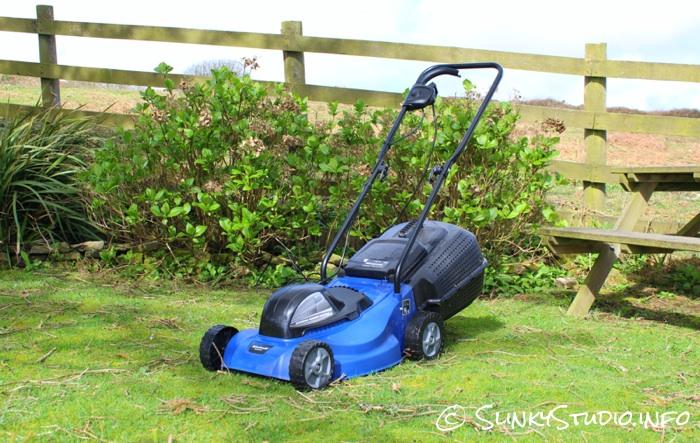 Einhell BG-EM 1437 Electric Lawnmower in Garden with Picnic Bench.jpg