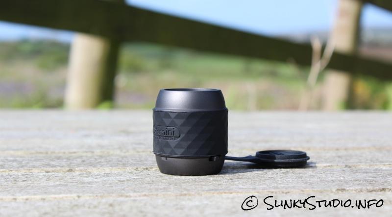 X-mini WE Speaker on Benech in front of wooden fench.jpg