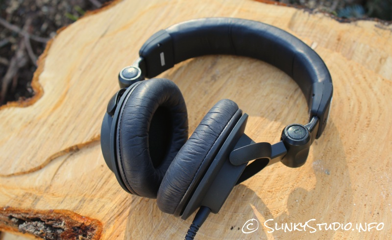 Ultrasone Signature Pro Headphones Lying on Cut Log.jpg