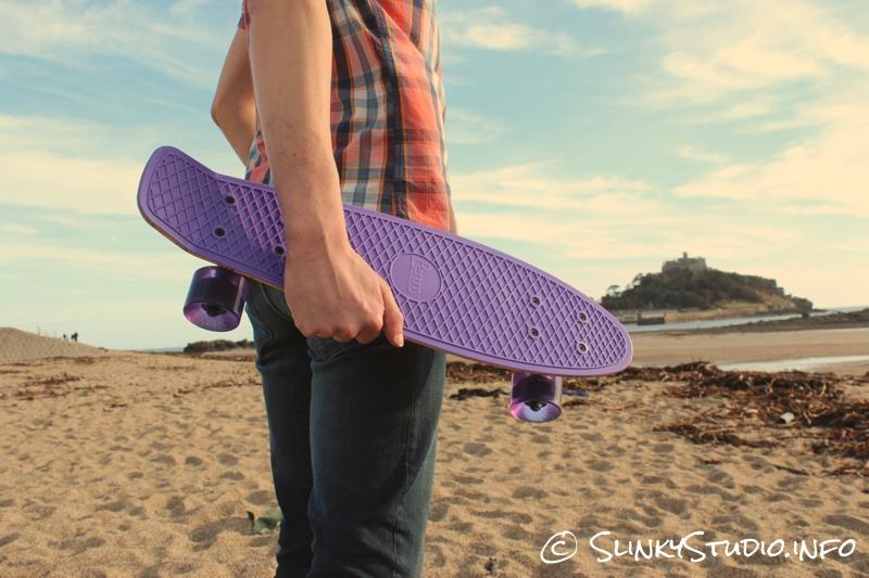 Penny Original Skateboard being carried on Marazion beach St Micheals Mount.jpg