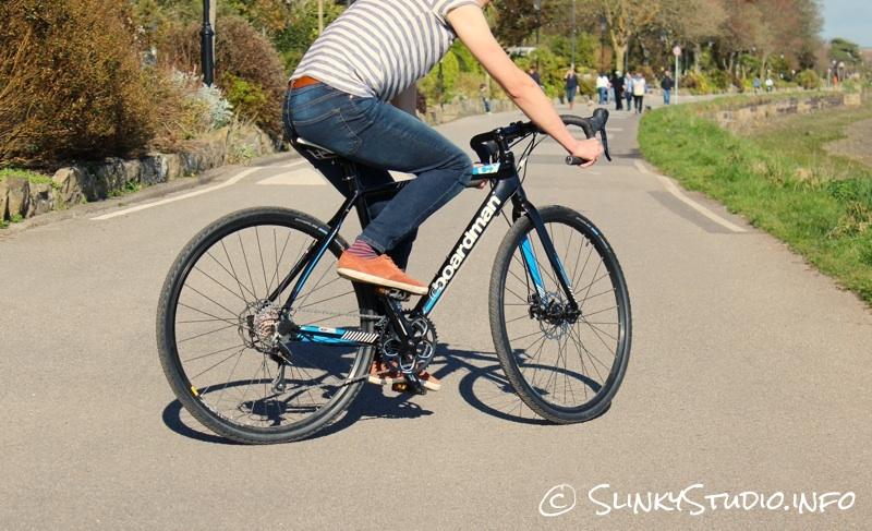 Boardman CX Comp Bike Riding on Asphalt in park like area.jpg