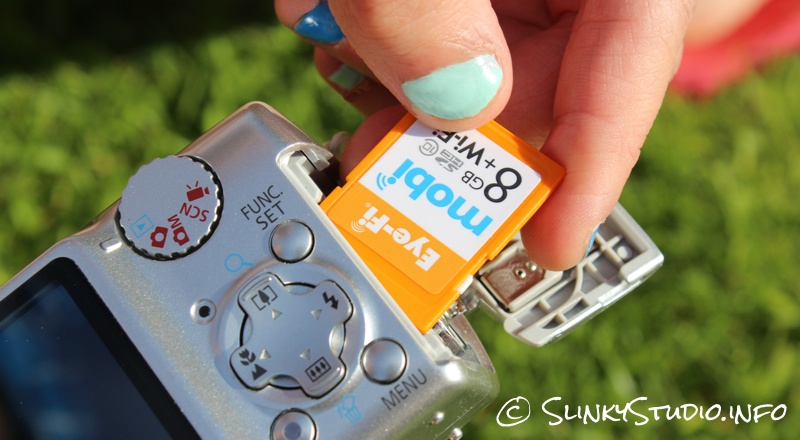 Eye-Fi Mobi Wireless SD Card Inserting Into Camera.jpg