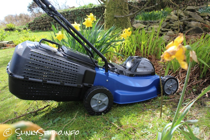 Einhell BG-EM 1437 Electric Lawnmower Side View in Sunny Garden.jpg