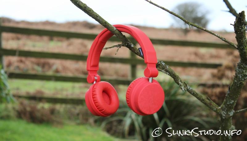 Urbanears Zinken Headphones Tomato Red Hanging On Tree Branch.jpg