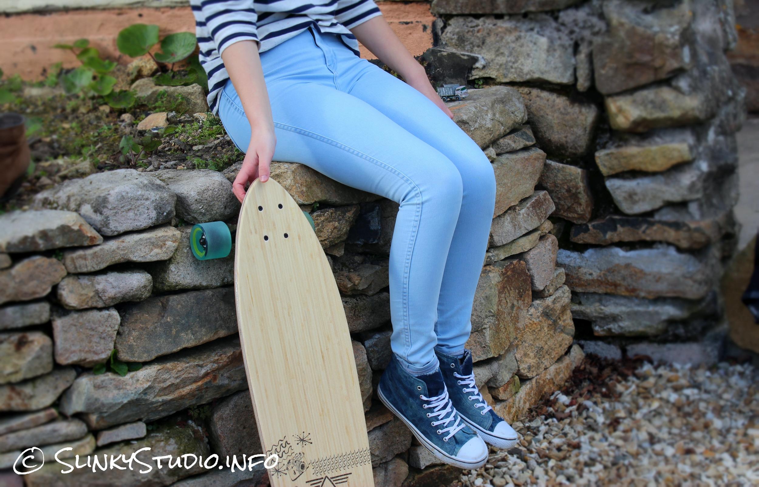 American Apparel Easy Jeans Medium Wash Sitting on Stone Wall with Longboard