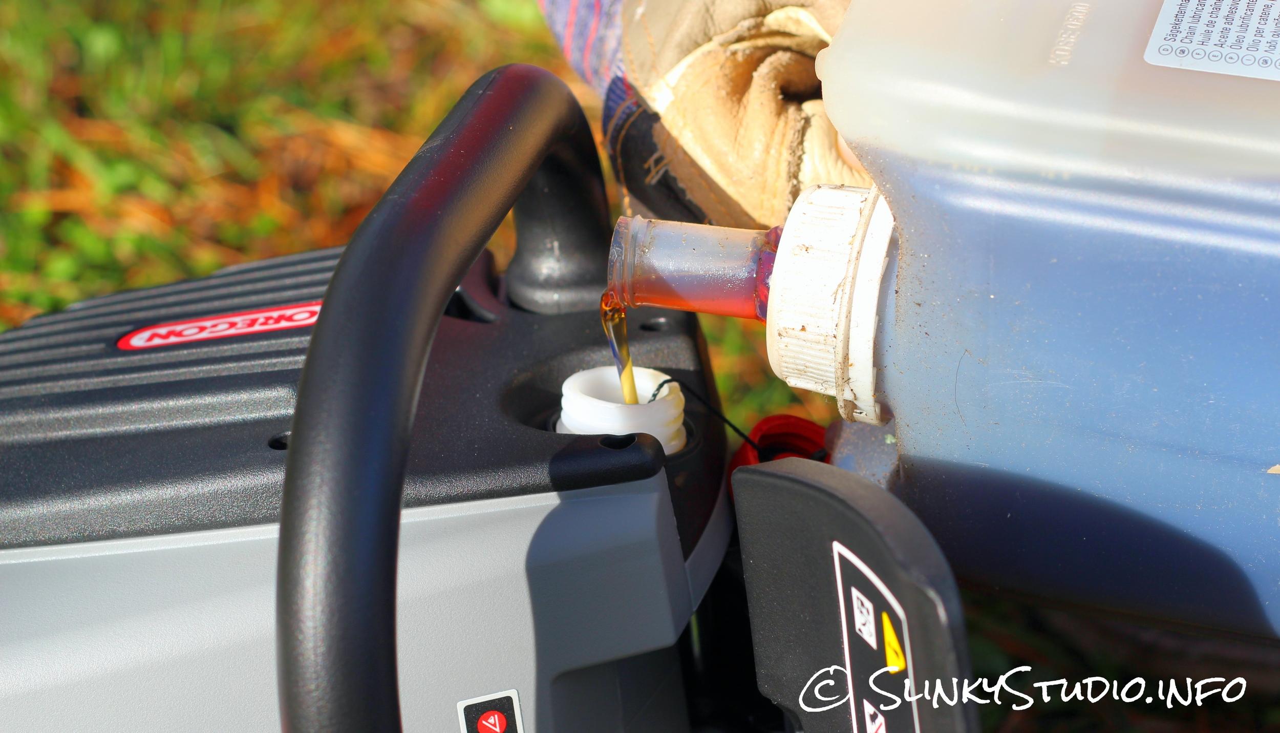 Oregon CS300 PowerNow Cordless Chainsaw Pouring Oil.jpg