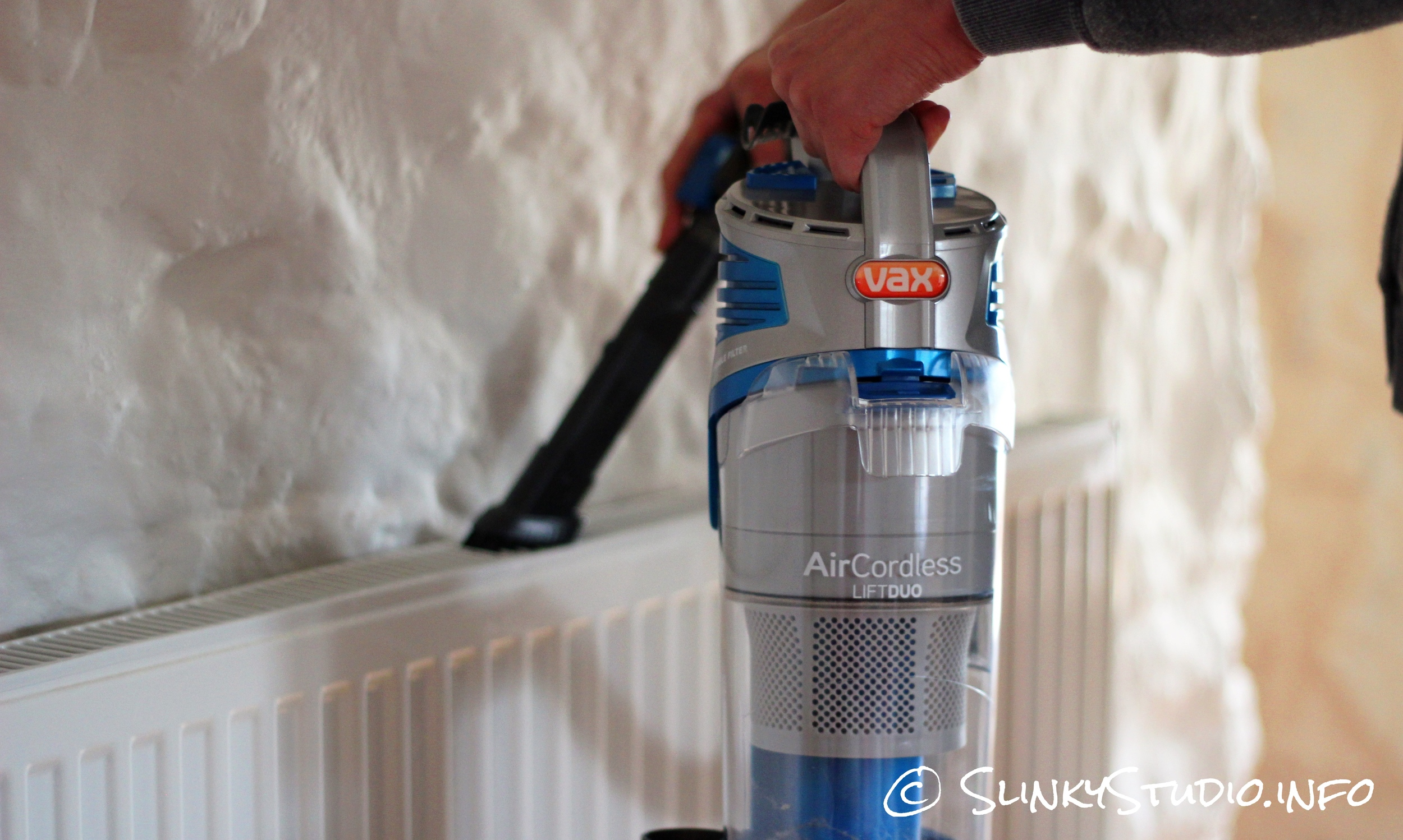 Vax Air Cordless Lift Holding Hose Cleaning.jpg