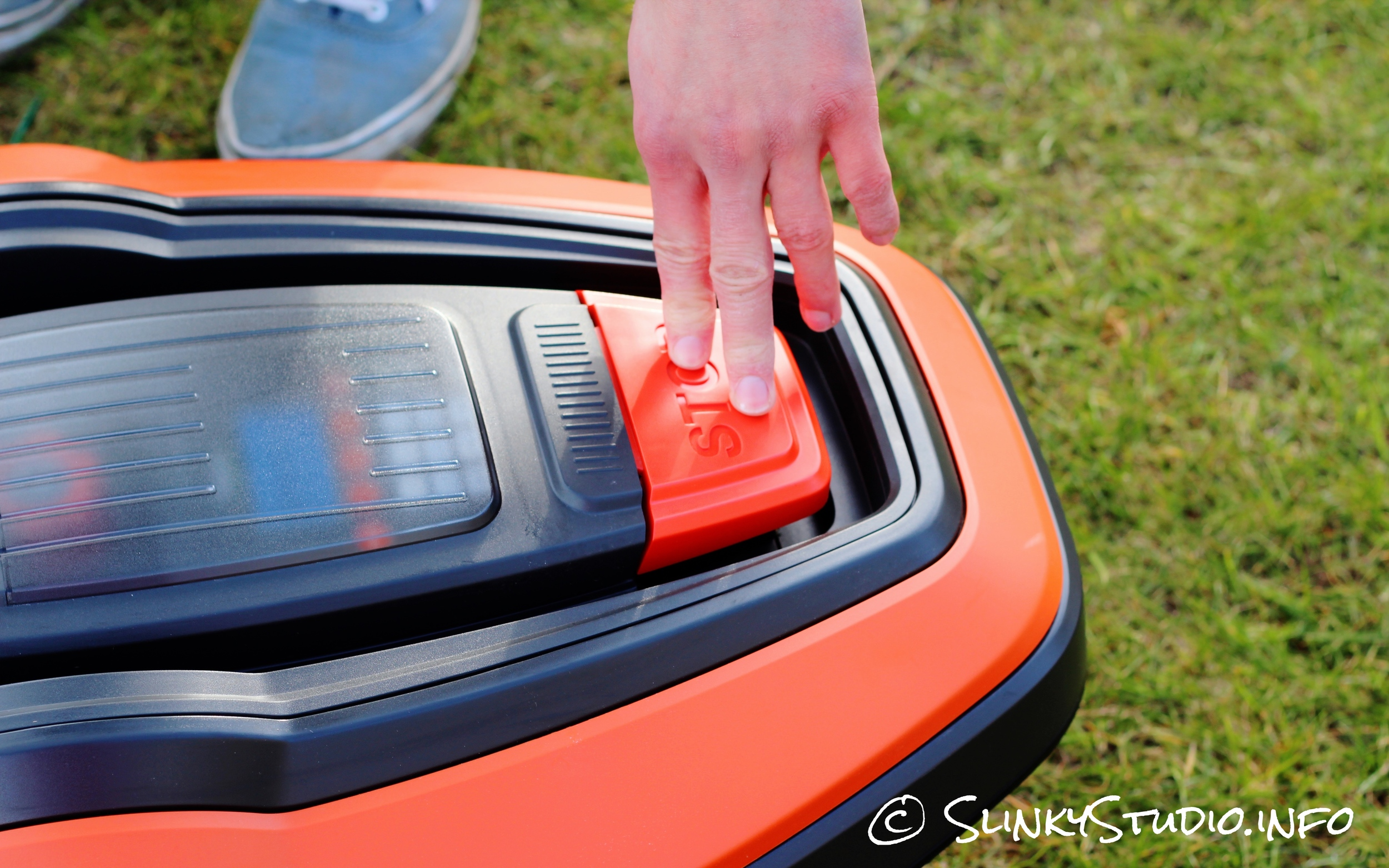 Flymo Robotic 1200R Lawnmower Stop Button being Pushed.jpg