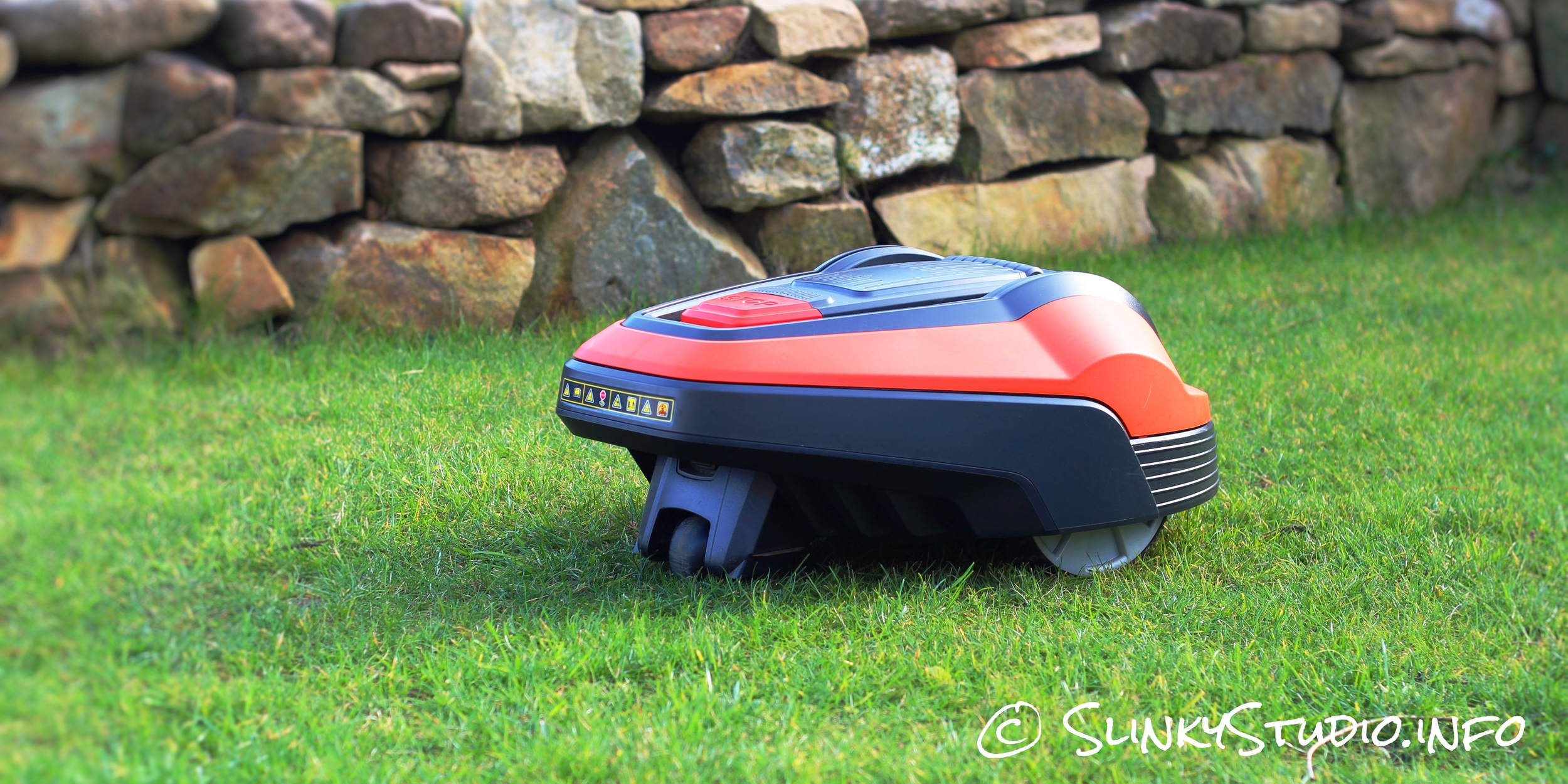 Flymo Robotic 1200R Lawnmower Mowing Lawn Side View.jpg